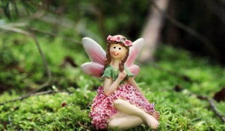 toy, doll, girl, wing, moss, nature, flower, object, figure