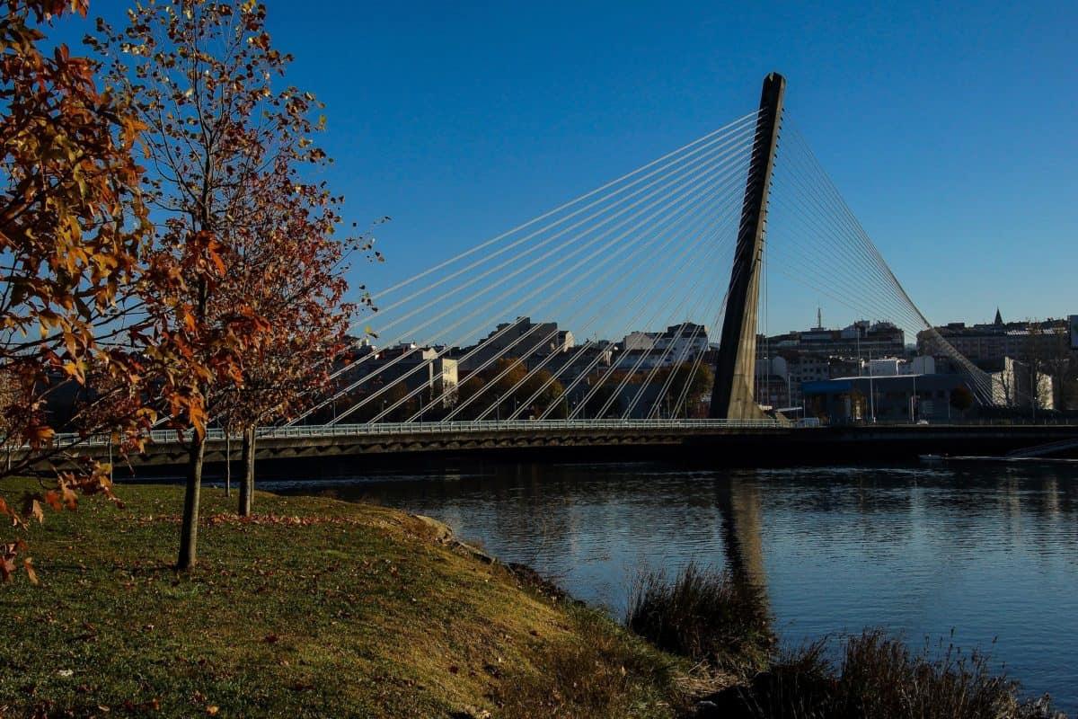 suspension bridge, water, bridge, structure, river, blue sky, outdoor, grass