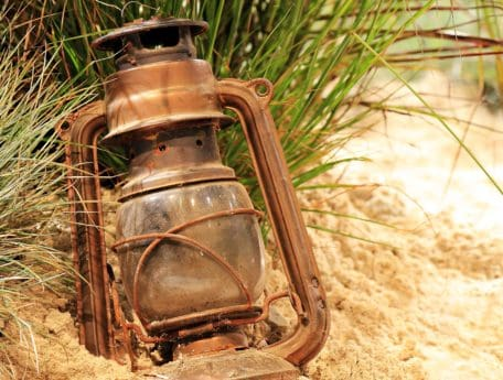 sand, ground, object, rust, metal, lamp, grass, old