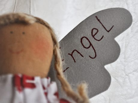 toy, angel, doll, object, material, text
