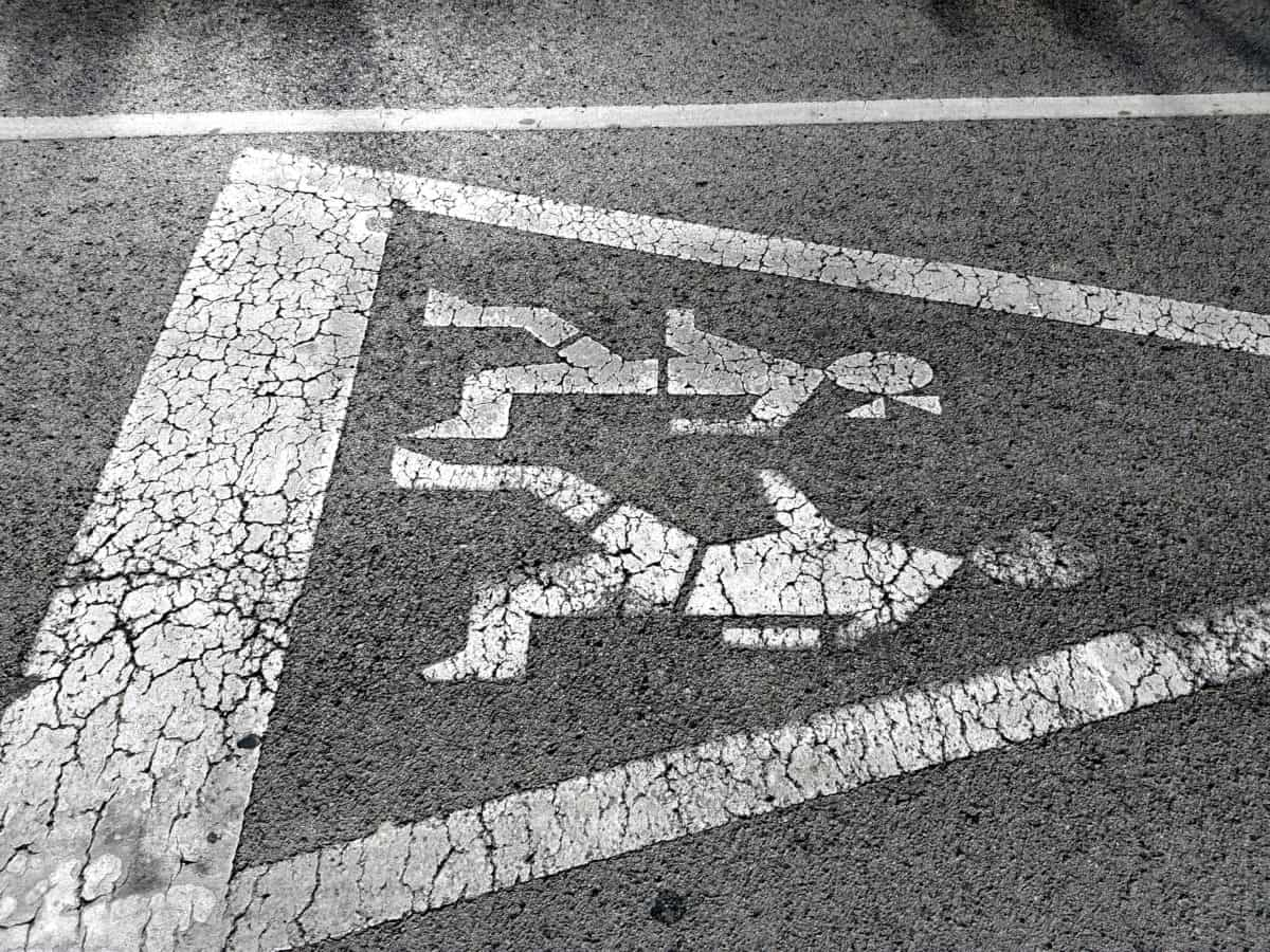 traffic sign, sign, monochrome, pavement, asphalt, road, street, ground