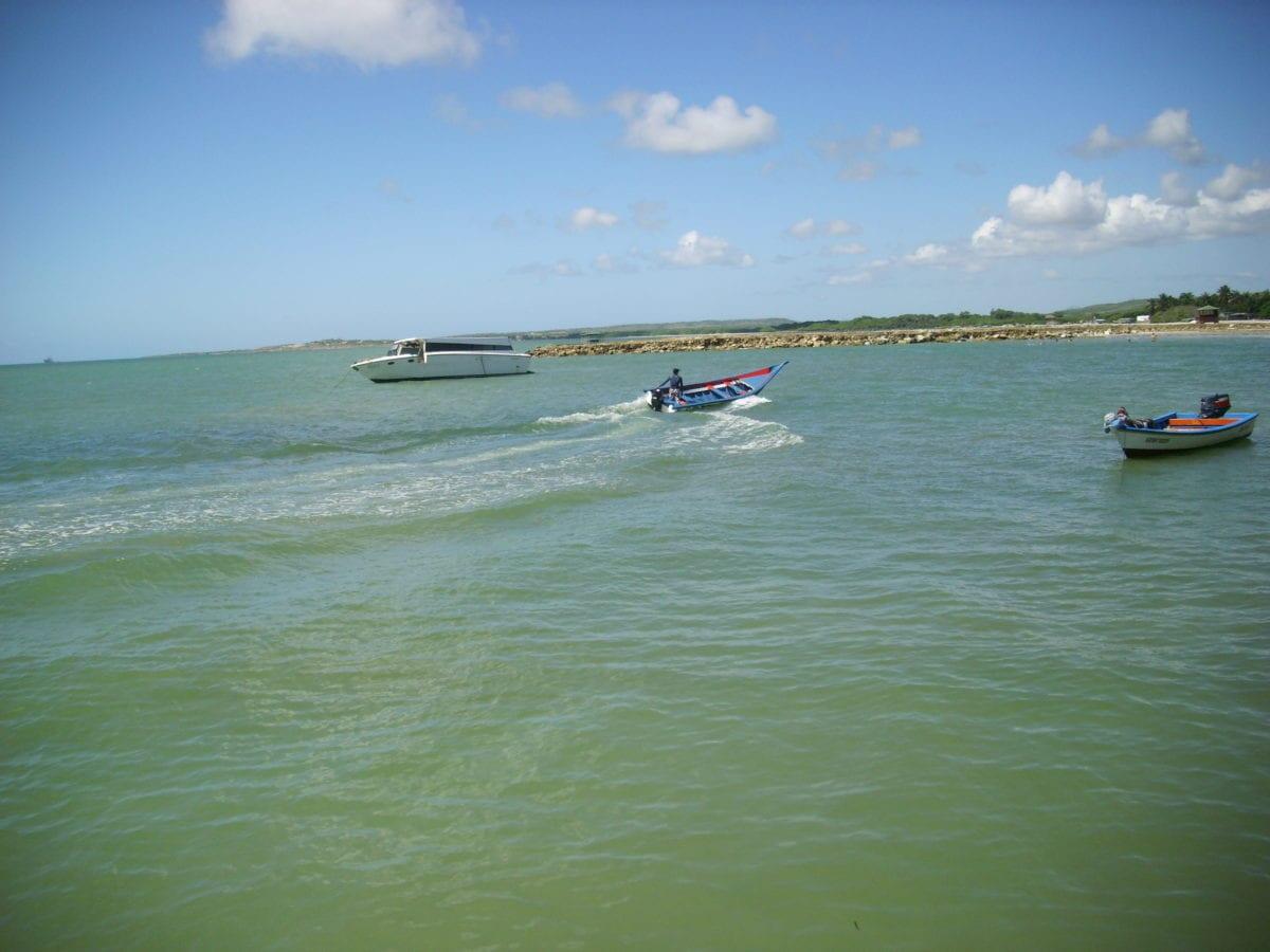 ocean, water, island, blue sky, boat, watercraft, beach, vehicle, sea