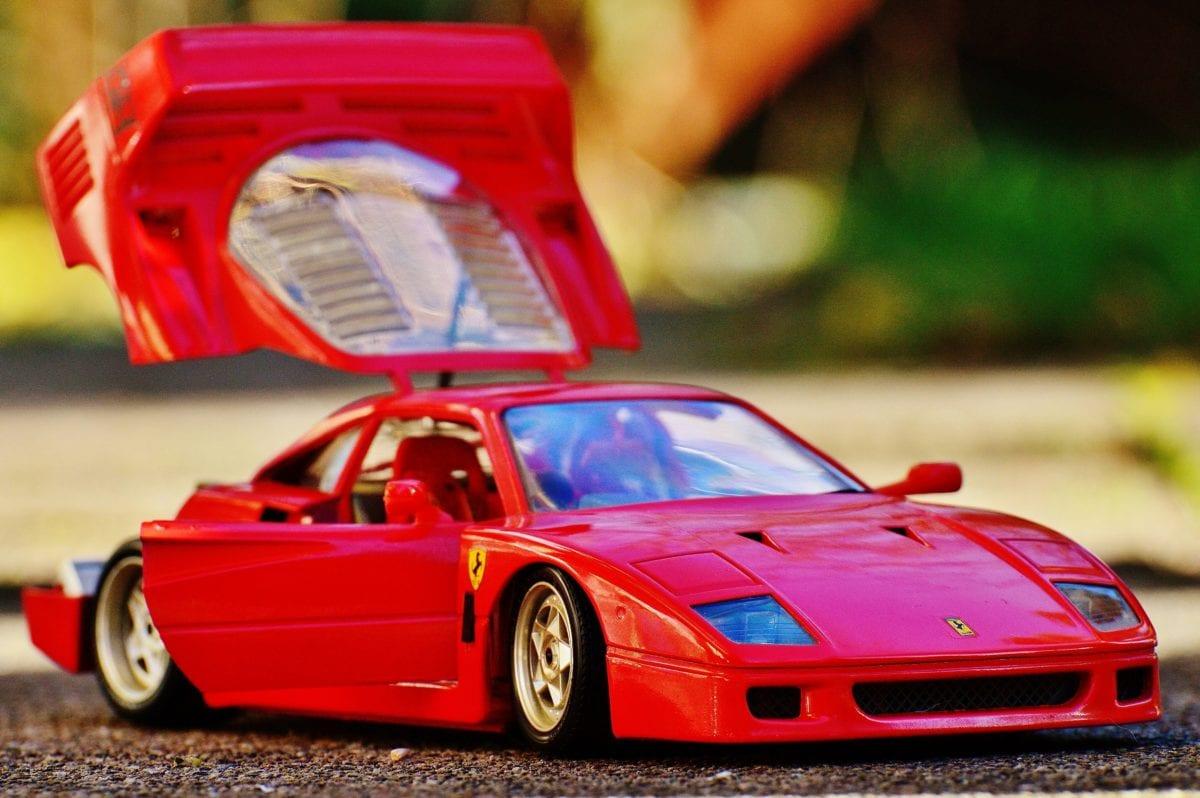 vehicle, toy car, race, red automobile, object, plastic, asphalt, transportation