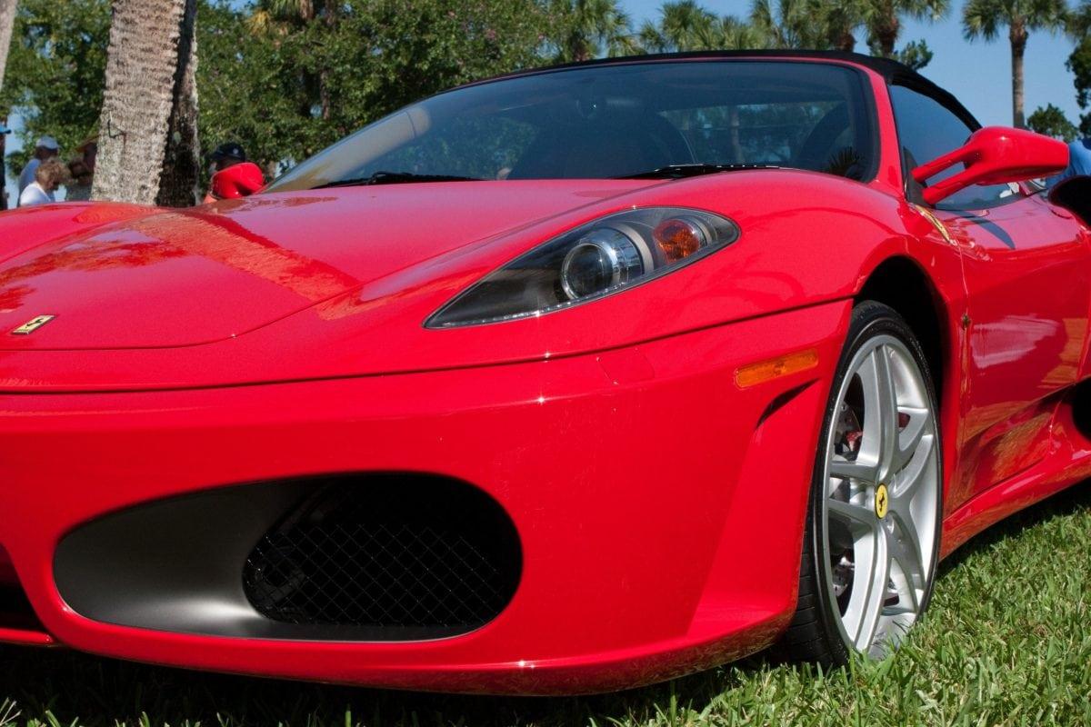 red car, wheel, vehicle, chrome, automotive, coupe car, automobile