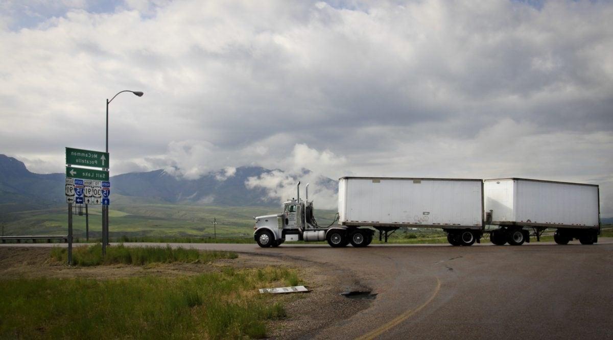 vehicle, big truck, road, landscape, field, sky, equipment, asphalt, outdoor