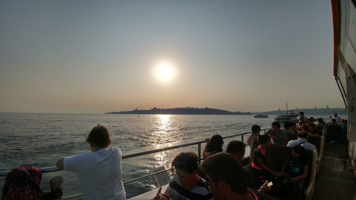 ocean, sunset, crowd, travel, tourism, people, sea, water, watercraft, beach, coast, shore