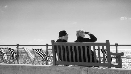people, beach, fence, monochrome, daylight, bench, sea, ocean, chair, outdoor