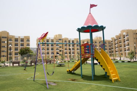 playground, daylight, area, park, building, location, grass, sky