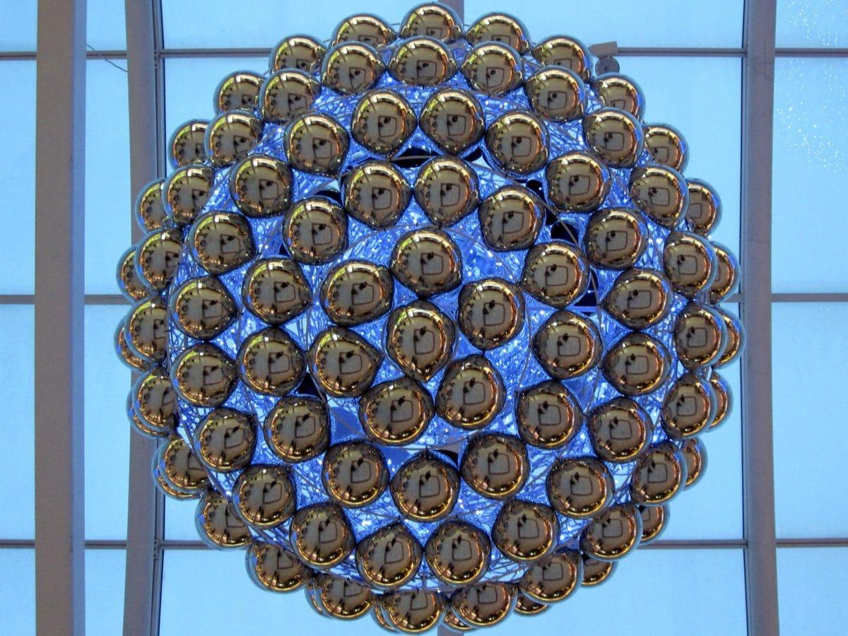 indoor, sculpture, modern art, circle, technology, steel