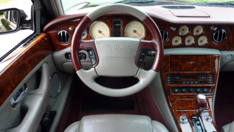 car seat, dashboard, interior decoration, old style, speedometer, steering wheel, windshield, car
