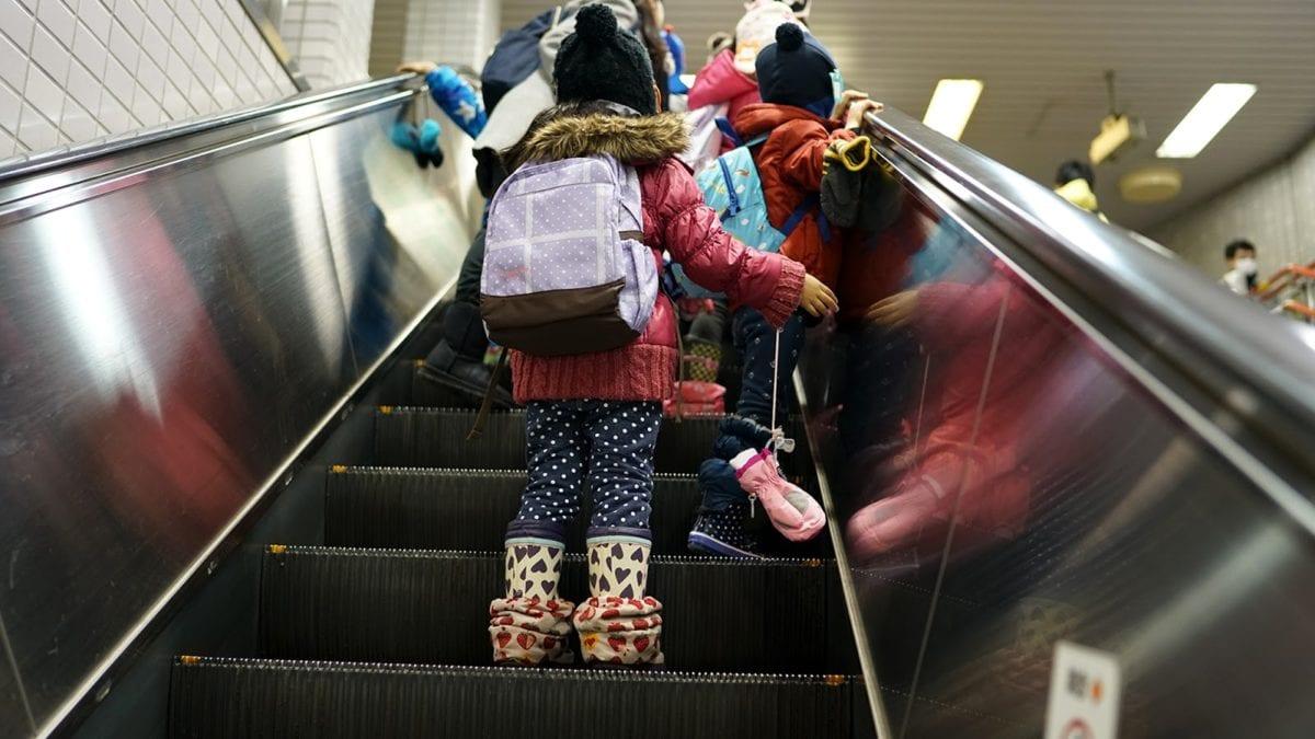 child, children, crowd, elevator, interior, motion, people, vehicle