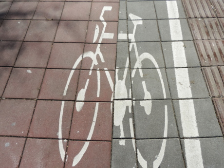 bicycling, sign, texture, tile, sidewalk, pavement, wall, urban