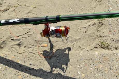 fishing gear, fishing rod, nylon, soil, sand, ground, road, outdoors