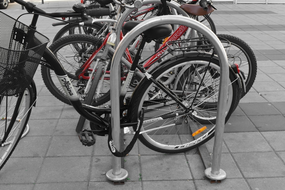 bicycle, parking lot, urban area, wheel, street, road, pavement, city