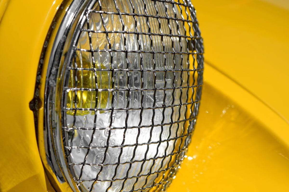 chrome, headlight, metal, metallic, yellow, outdoors, equipment, reflection
