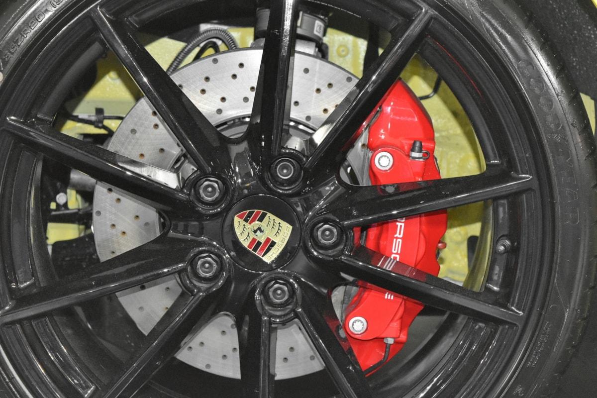 sports car, brake, wheel, transportation, vehicle, car, tire, rim