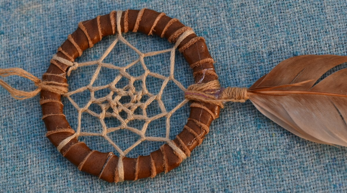 circle, decoration, feather, leather, object, rope, pattern, upclose