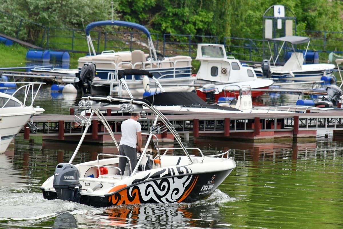 person, yacht club, yachts, hovercraft, water, speedboat, boat, ship, motorboat, river