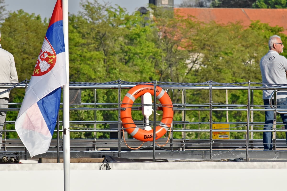 cruise ship, flag, Serbia, life preserver, people, outdoors, chair, building, business, man