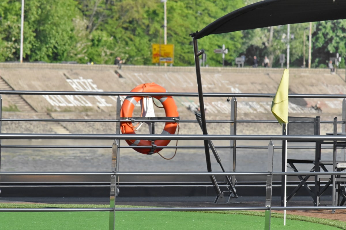 cruise ship, golf, life preserver, equipment, float, outdoors, competition, daylight, summer, recreation