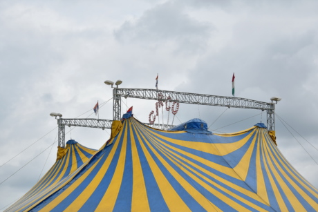 tent, circus, festival, outdoors, rope, landscape, flag, color, blue sky, city