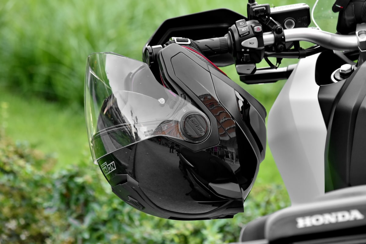 motorcycle, steering wheel, vehicle, helmet, outdoors, drive, championship, competition, chrome, leisure