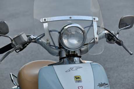 headlight, mirror, moped, steering wheel, windshield, chrome, classic, cloud, conveyance, detail
