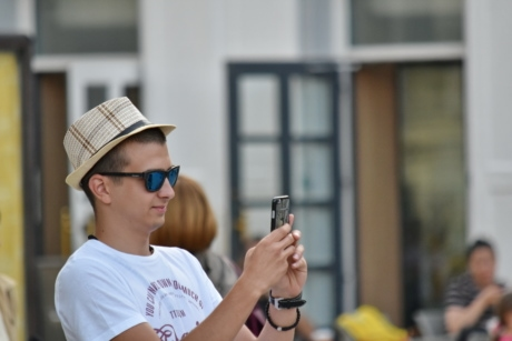 cellphone, handsome, hat, man, photographer, side view, street, people, portrait, daylight