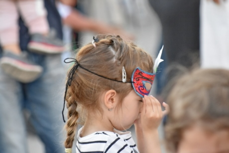 child, mask, pretty girl, side view, people, festival, cute, street, parade, fun