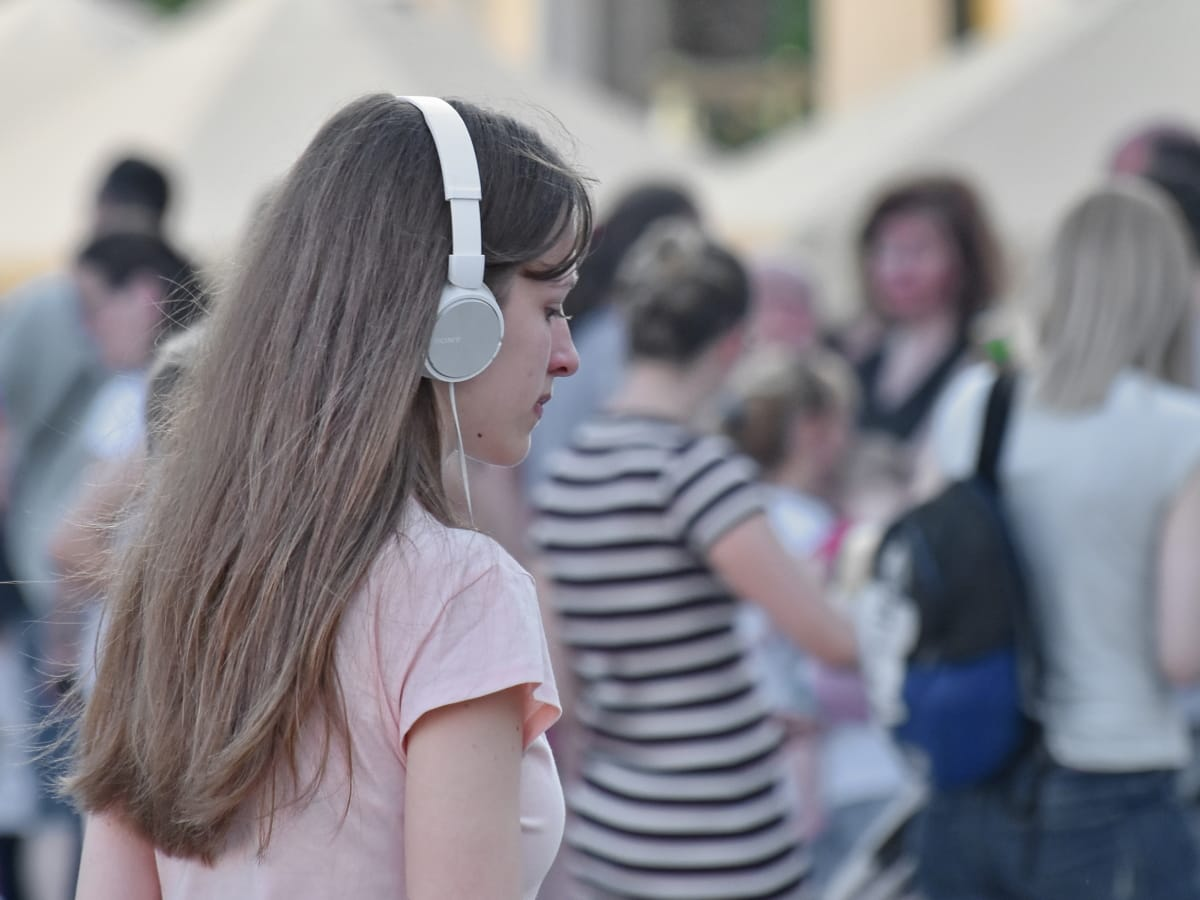 crowd, hairstyle, headphones, music, pretty girl, young woman, woman, people, girl, street
