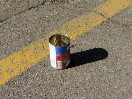 canister, concrete, garbage, metal, parking lot, road, container, street, asphalt, pollution