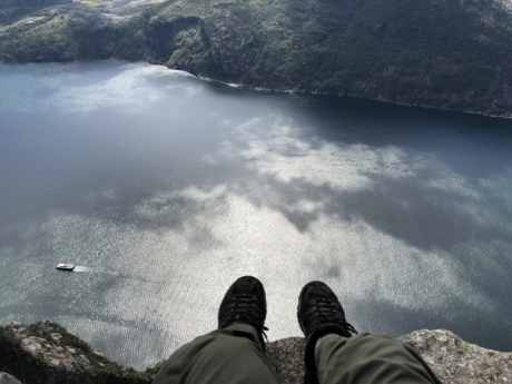 cliff, high land, lakeside, legs, mountain climbing, person, mountain, water, lake, landscape