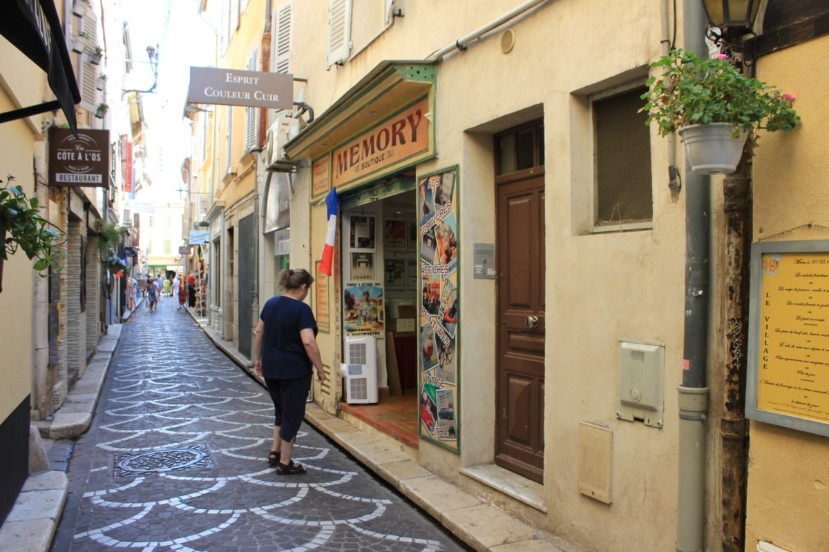narrow, street, tourist attraction, woman, city, architecture, shop, sidewalk, building, bookshop