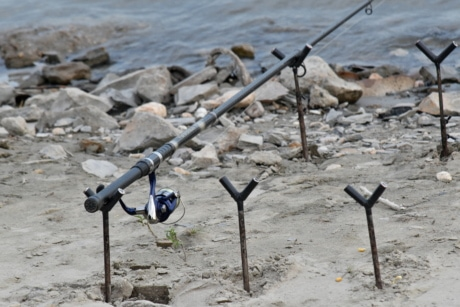 equipment, fishing gear, fishing rod, object, riverbank, rocky river, water, landscape, nature, sand