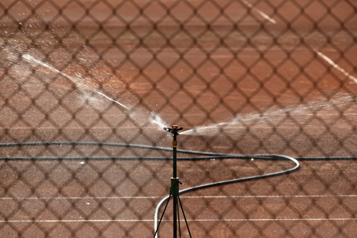 hose, irrigation, spraying, tennis court, fence, barrier, safety, protection, competition, outdoors