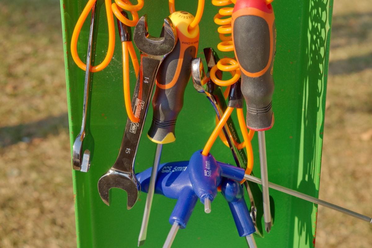 hand tool, screwdriver, wrench, scissors, equipment, plastic, steel, tool, nature, grass