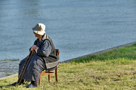 chair, elderly, grandmother, hat, pensioner, relaxation, riverbank, senior, side view, sticks