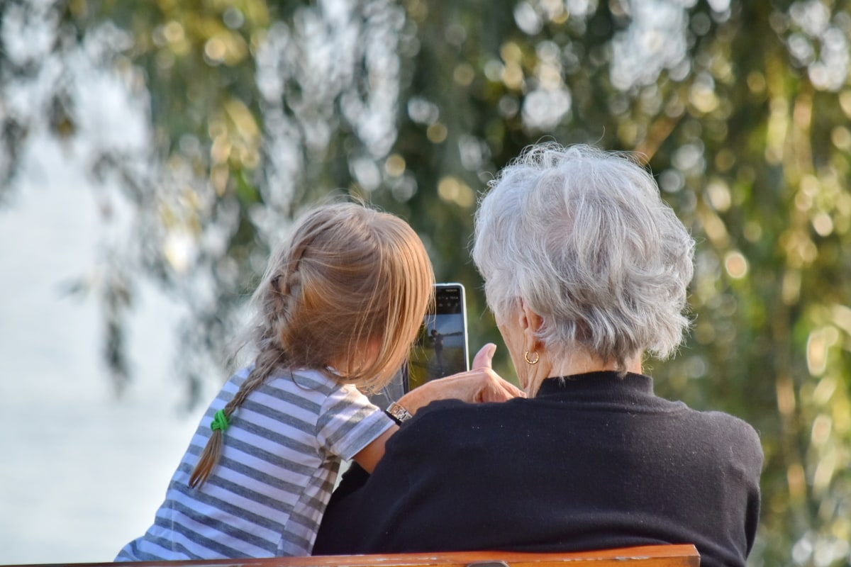 enjoyment, entertainment, family, granddaughter, grandmother, mobile phone, summer season, outdoors, happy, love