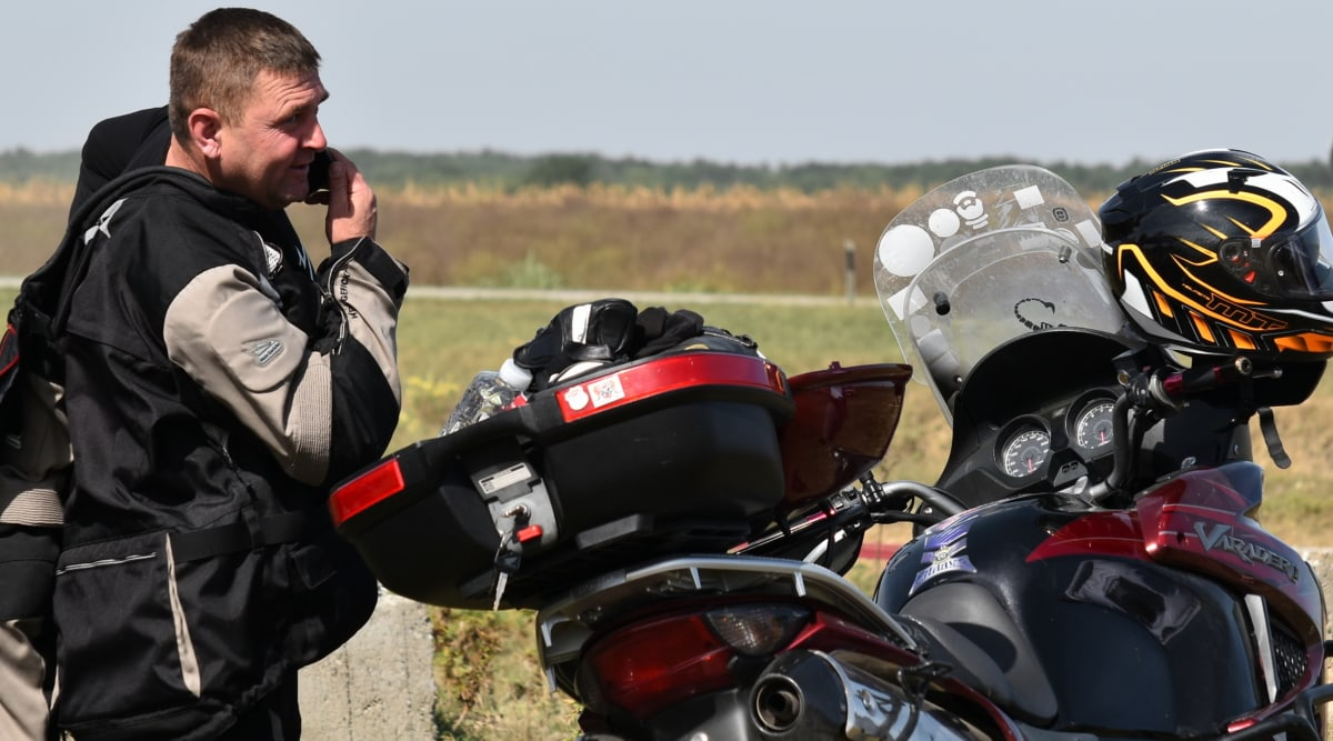 conversation, mobile phone, motorcycle, motorcyclist, telecommunication, bike, seat, vehicle, race, competition