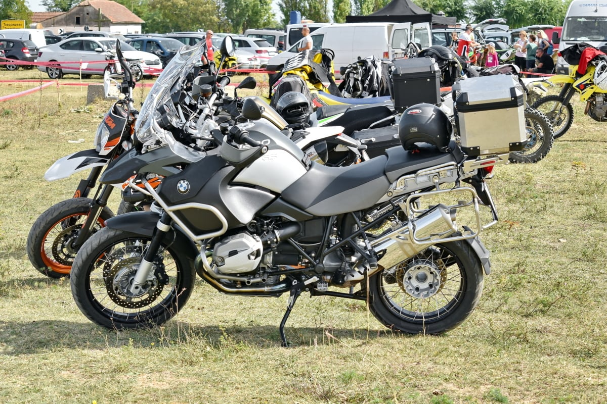 festival, parking lot, rural, village, motorcycle, vehicle, wheel, motorbike, conveyance, motor