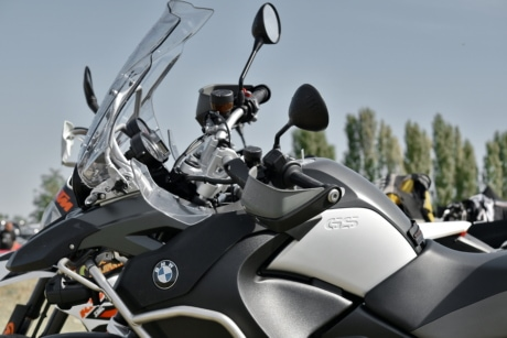 motorbike, parking lot, side view, sunshine, windshield, vehicle, transportation, seat, chrome, competition