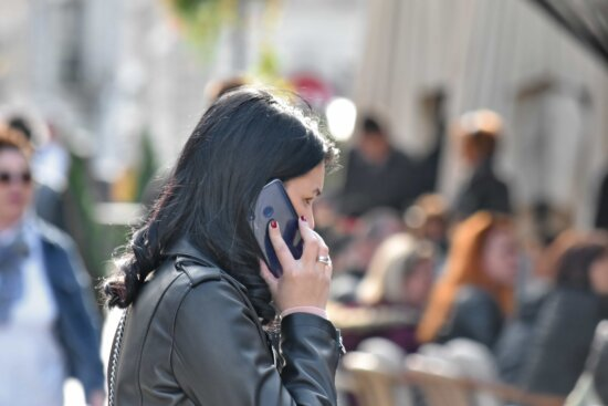 communication, crowd, gorgeous, mobile phone, people, pretty girl, speaking, street, person, woman