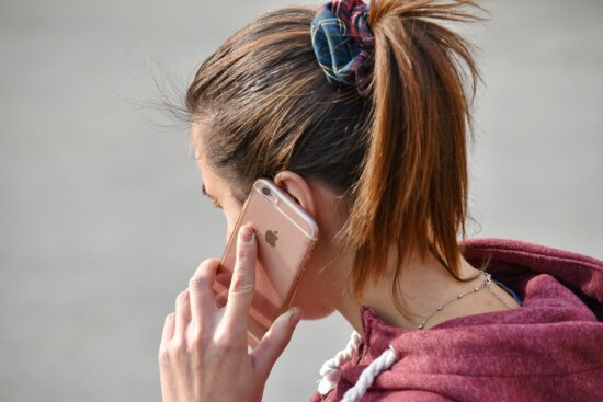 businessperson, businesswoman, call, communication, conversation, hairstyle, mobile phone, side view, teenager, young woman