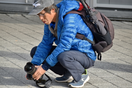 angle, camera, equipment, eyeglasses, hands, lens, pavement, perspective, photographer, photojournalist