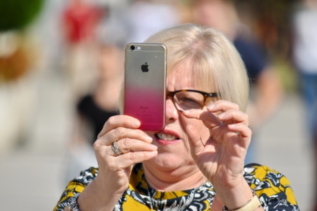 apple computer, blonde hair, face, finger, mobile phone, portrait, woman, telephone, outdoors, people