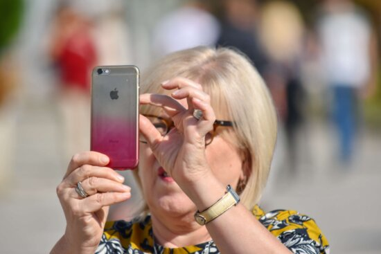 apple computer, blonde hair, famous, mobile phone, woman, summer, outdoors, fun, leisure, child