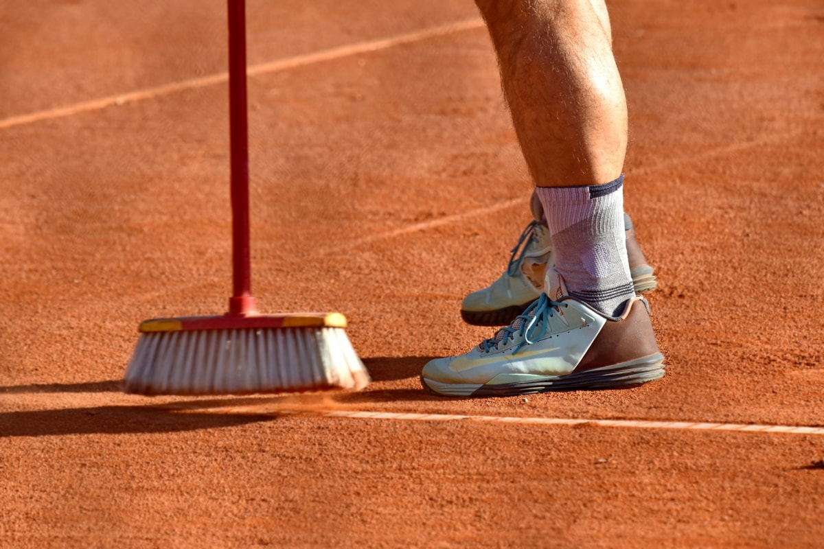 cleaning, dust bowl, footwear, preparation, sneakers, tennis court, broom, stadium, competition, recreation