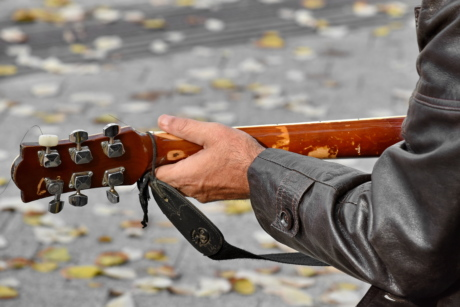 acoustic, autumn season, festival, guitar, guitarist, jacket, leather, man, street, skill