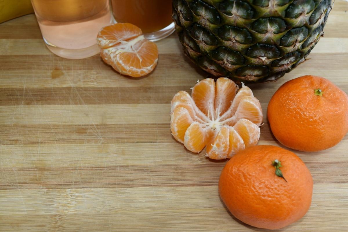 fruit juice, kitchen table, mandarin, pineapple, produce, tangerine, orange, food, citrus, fruit