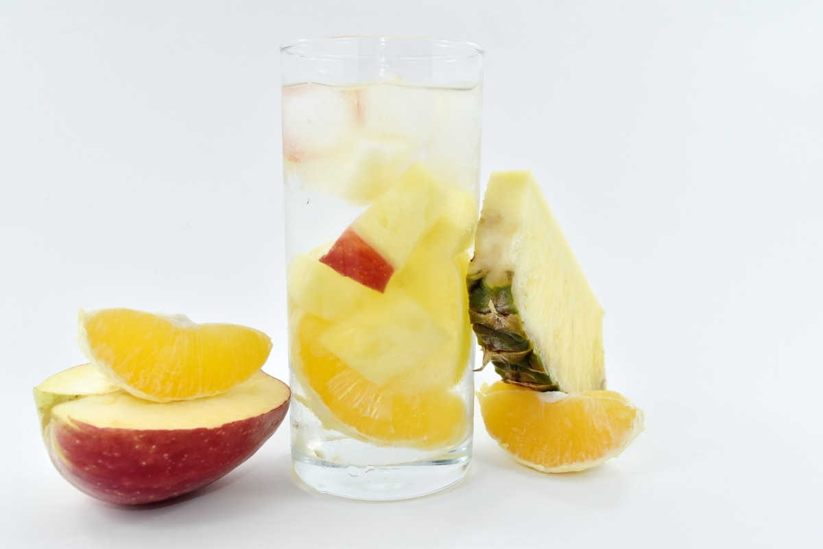 apple, citrus, cold water, fresh water, fruit cocktail, fruit juice, ice, pineapple, glass, fruit